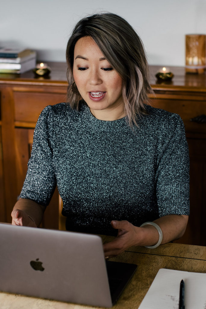 Dr Jin Ong Coaching Emotional Release Techniques online from her macbook